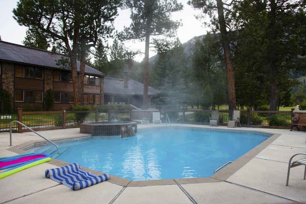The lodge is equipped with amenities like a pool and hot tub.
