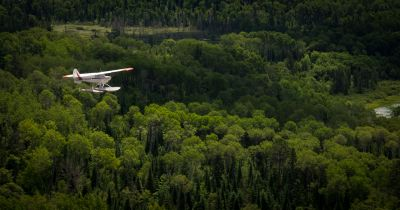 Andy Brown pilots his Aviat Husky A-1A along the Vermillion River